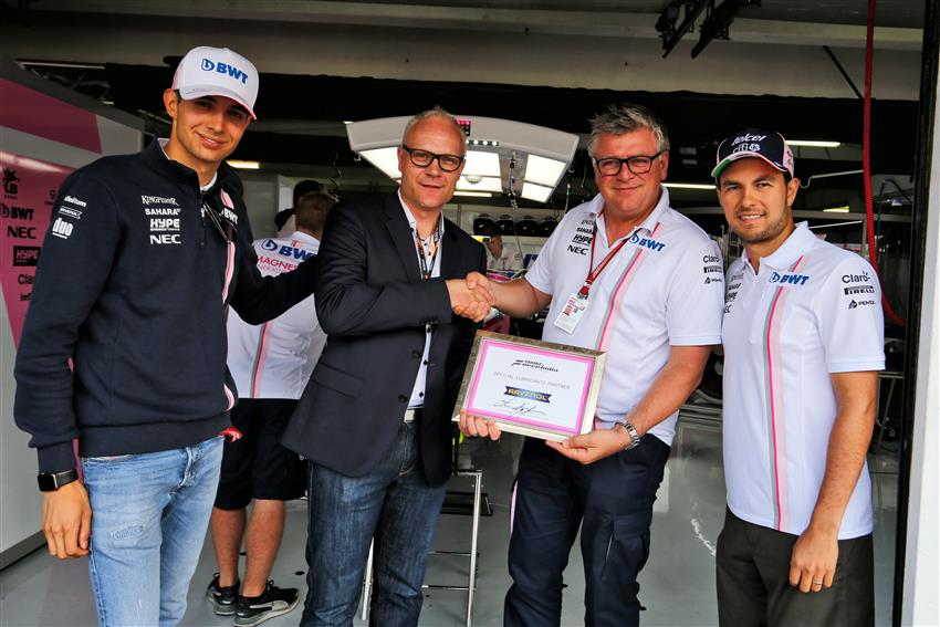 RAVENOL Motorsport Director Martin Huning accepts the official Force India Technical Partnership certificate from Otmar Szafnauer, Esteban Ocon and Sergio Perez