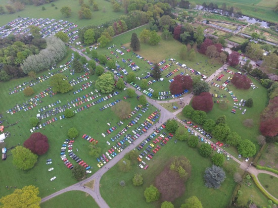 aerial photo of display cars at sports cars in the park